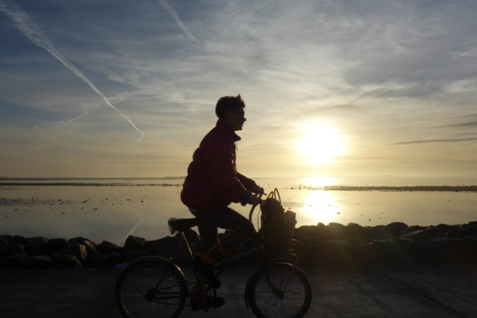 cyclist rides Galway coastline ireland bicycle